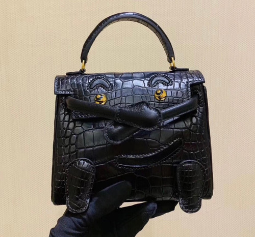 Hermes Kelly Idole (Kelly Doll) in Black Alligator with Gold hardware.