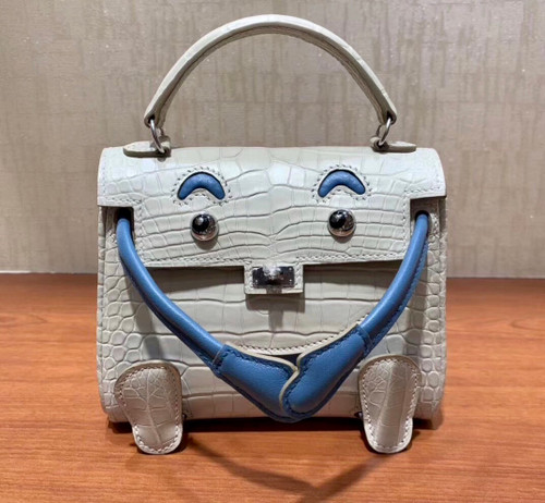 Hermes Kelly Idole (Kelly Doll) in GRIS PERLE Alligator with Palladium hardware.