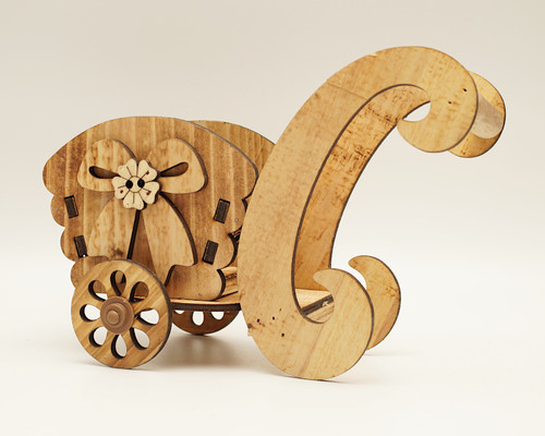 """8.5"""" x 6.5"""" Brown Wooden Laser-Cut Carriage with Movable Wheels  - 1 Centerpiece"""
