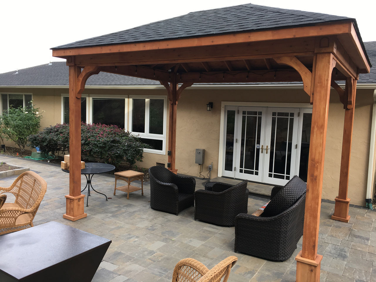 "14-3"" x 11'-0"" roof span Red Cedar Pavilion - Traditional Roof / 6""x6"" sq. columns extended length / Electrical kit / Heavy Duty Anchors / Black roof shingles / Sealant/stain combo by Sikkens #77 Red Cedar / San Rafael, CA."