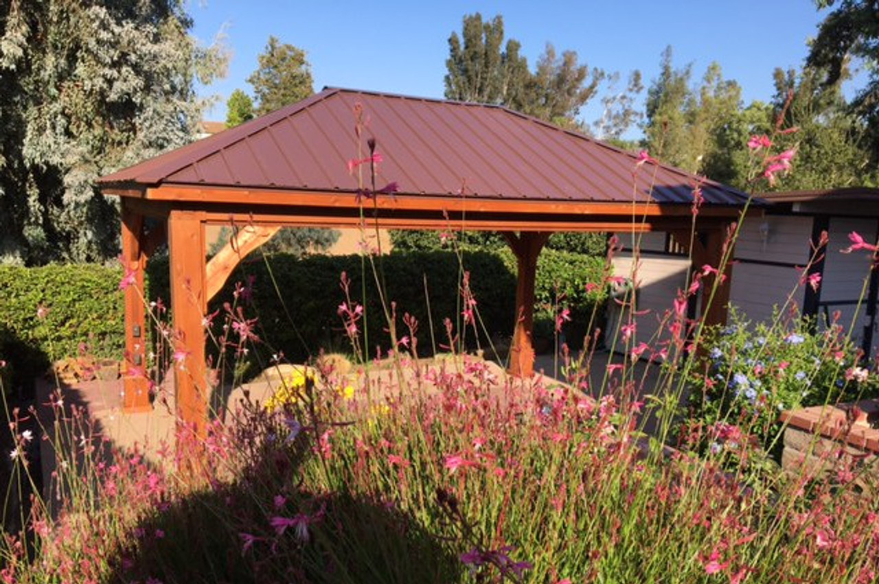12x18 Traditional Roof Pavilion, Western Red Cedar #1 Grade, Brown metal roof, Cedar Color stain & sealant, 8in sq posts, electrical trim kit, and ceiling fan mount. Simi Valley, CA.