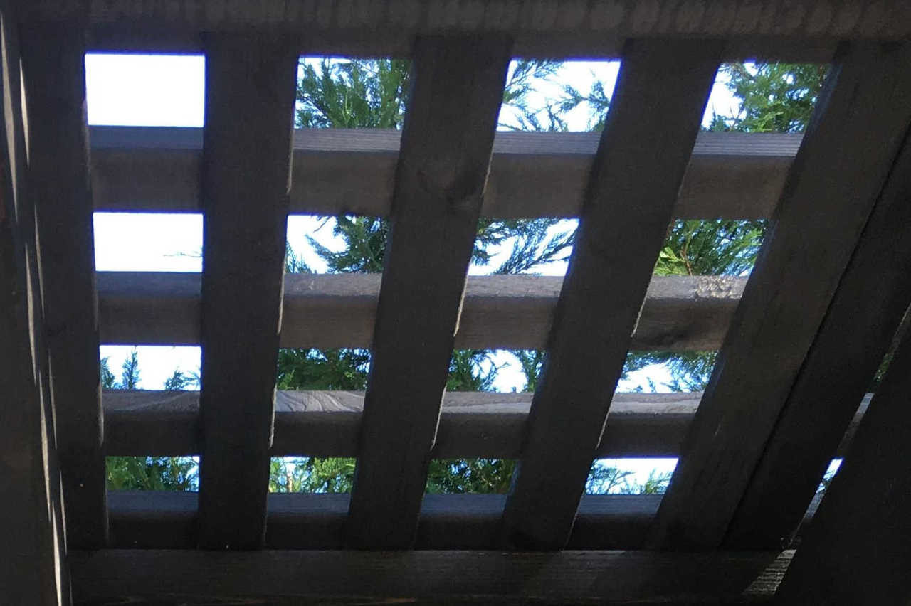 "Our lattice roof panels are made from 1"" x 2"" runners. These have been stained Cinder color. Combined with the 2x6's and 2x2's below, the roof offers shade of 82%."