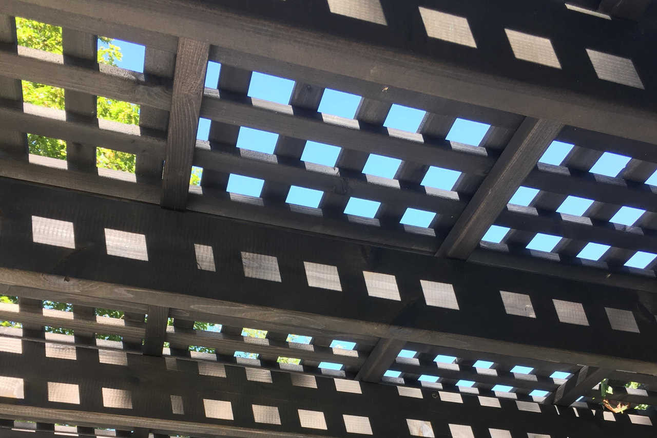 "Our lattice roof panels are made from 1"" x 2"" runners. These panels are atop an 8x16 Classic Pergola Kit stained Cinder color. Combined with the 2x6's and 2x2's below, the roof stops 82% of the sun's rays."
