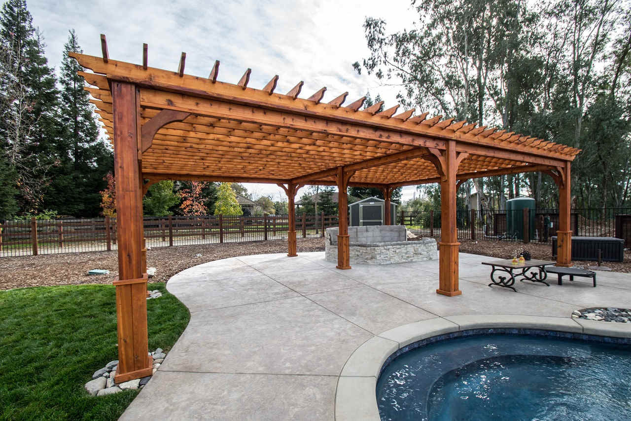 "32' x 22' post to post (outside of posts), 34' x 24' roof span / 8"" sq. posts, 12' high / 2x6 top runners 12"" apart on center running 32' / nine posts / standard anchors / Western Red Cedar / Elk Grove, CA."
