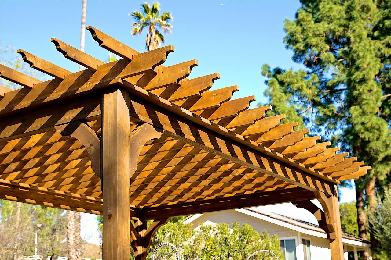 "15' x 10' Serenity Cedar Pergola Kit / Western Red Cedar / 18"" overhang / Top runners spaced 12"" apart on center / Walnut Stain / Thousand Oaks, CA."