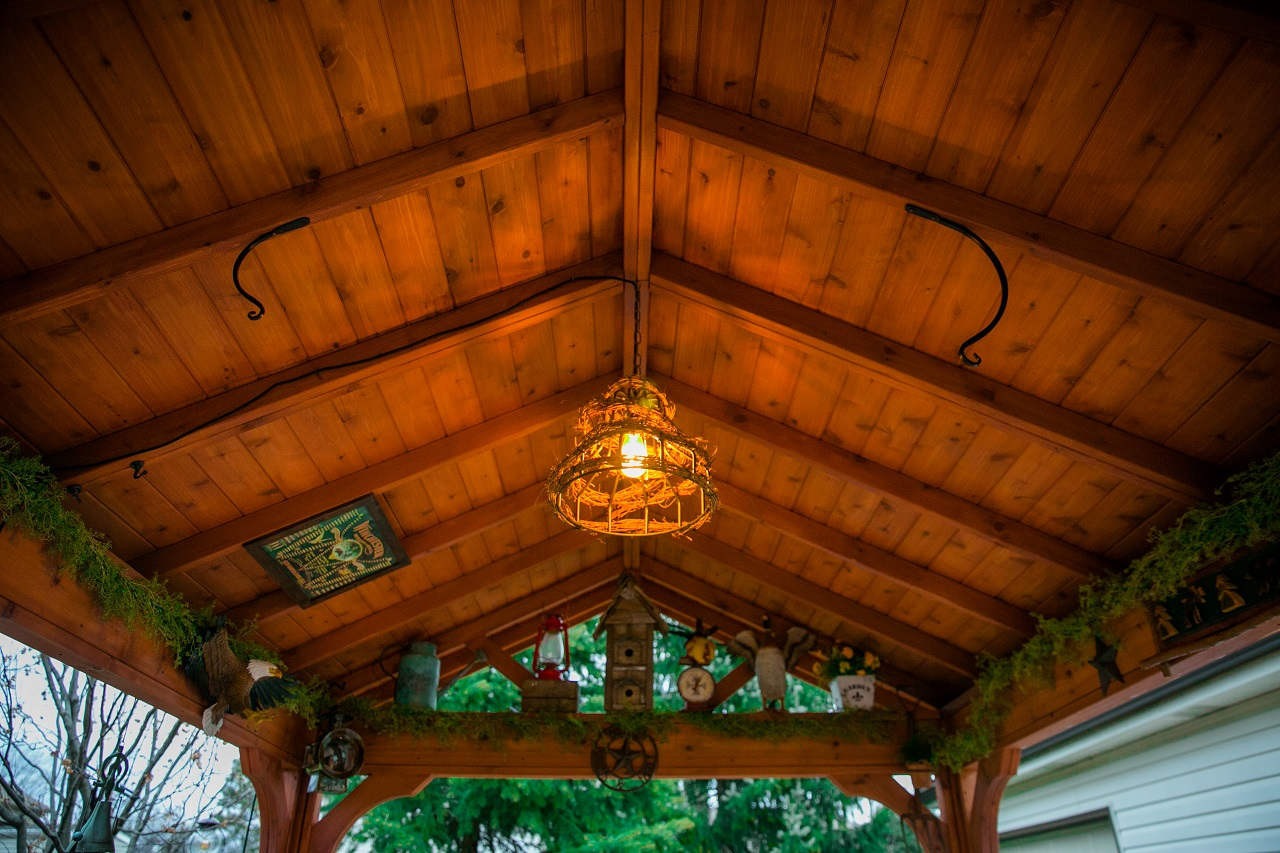 "1"" x 6"" red cedar tongue and groove roof panels illuminated in the evening / 2"" x 4"" rafters / 4"" x 4"" ridge beam / 14' x 10' Gabled Roof Pavilion, Western Red Cedar, Burbank, IL"