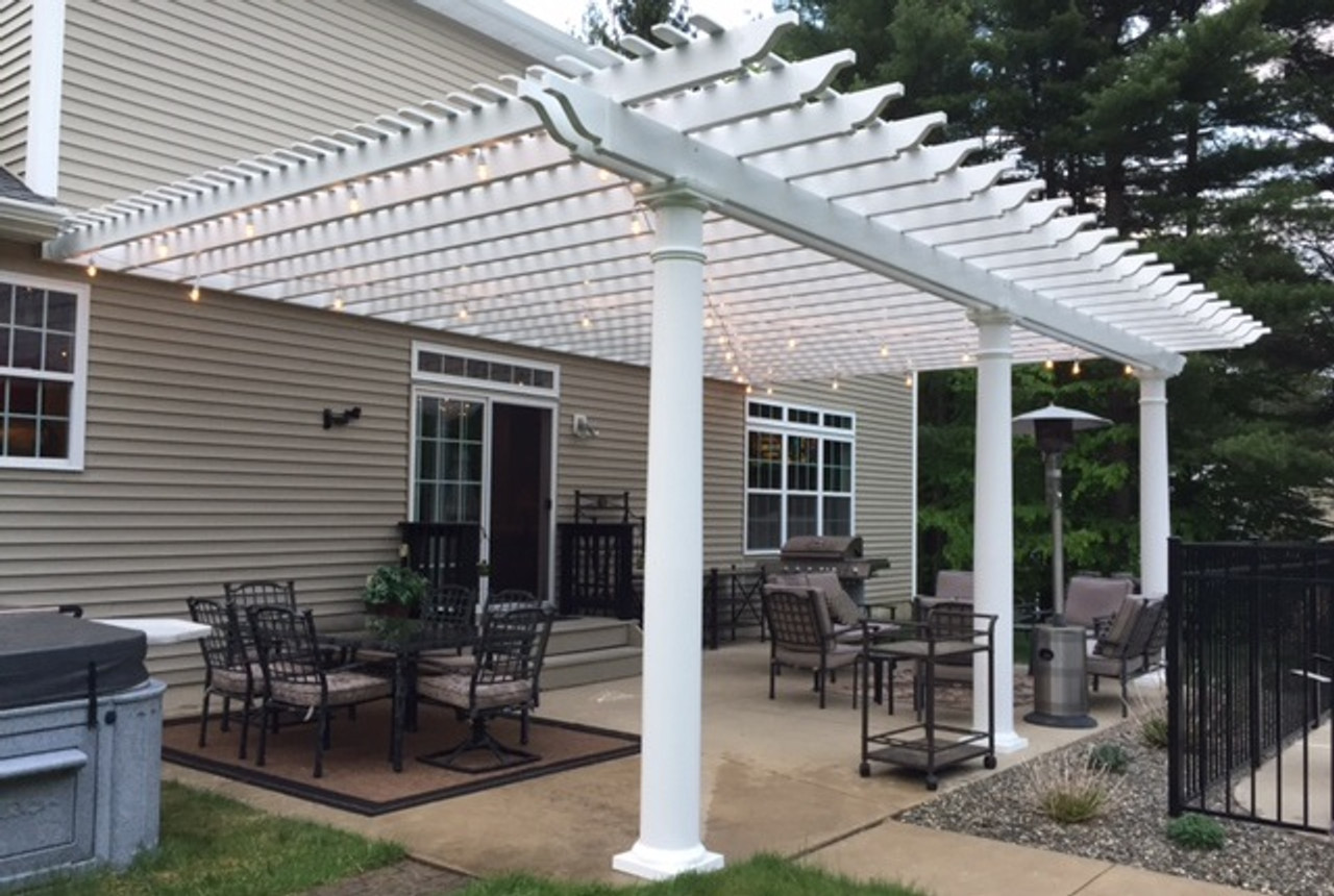 "Classic Premium Vinyl Pergola (three column wall mounted) Roof span 28'-9"" x 18'-9"" / Round tapered columns 10"" wide and 9'-2"" high / Extra 1"" x 3"" top runners included for additional shade / Porter Corners, NY."