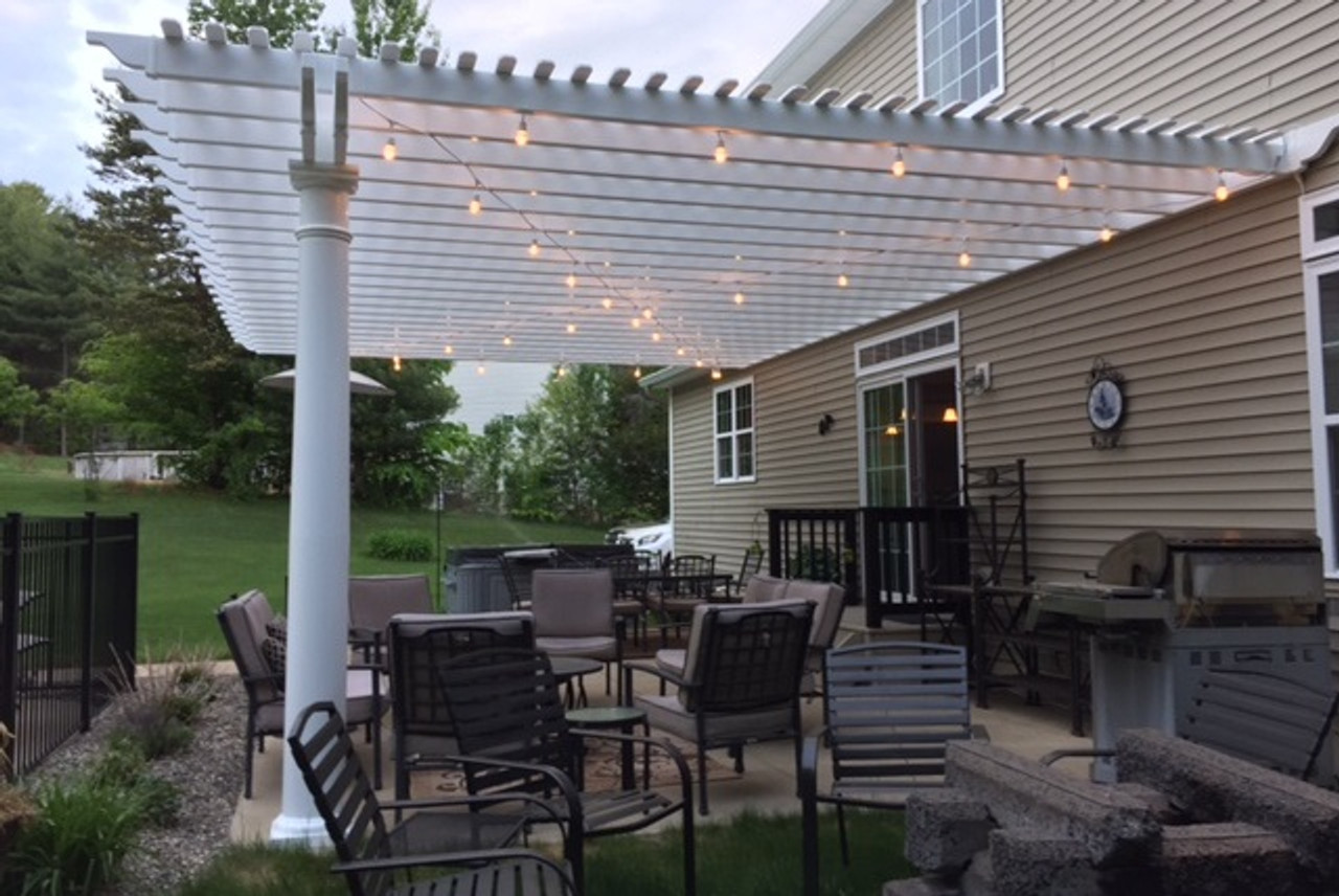 """Classic Premium Vinyl Pergola (three column wall mounted) Roof span 28'-9"""" x 18'-9"""" / Round tapered columns 10"""" wide and 9'-2"""" high / Extra 1"""" x 3"""" top runners included for additional shade / Porter Corners, NY."""