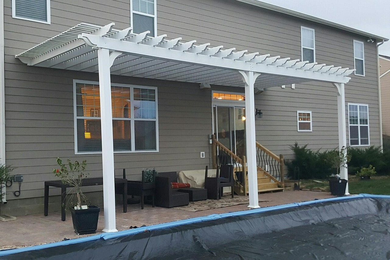 "28x10 (post to post) wall-mounted Classic Vinyl Pergola. Roof span dimensions 30x11 / 12' high columns / Fan mount /  Extra 1"" x 3"" top slats to provide 80% shade / 5"" square columns / Carmel, IA."