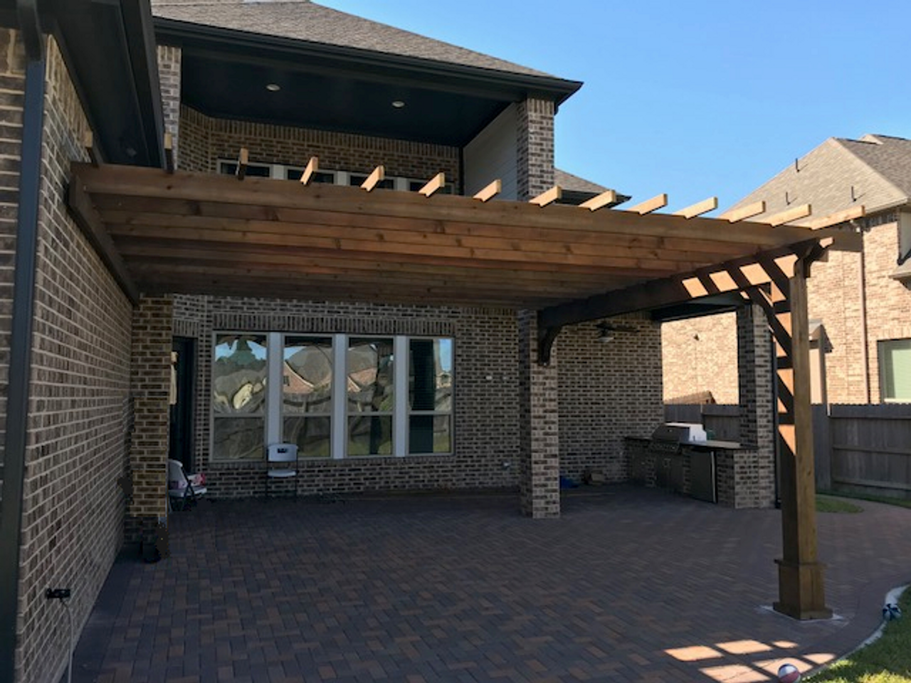 15x17 Classic Pergola Kit / wall mounted / 8in square posts, 10ft tall / Walnut stain / 2x12 beams, 2x8 rafters, 2x4 top runners / Straight cut ends on rafters and top runners / Spring, TX