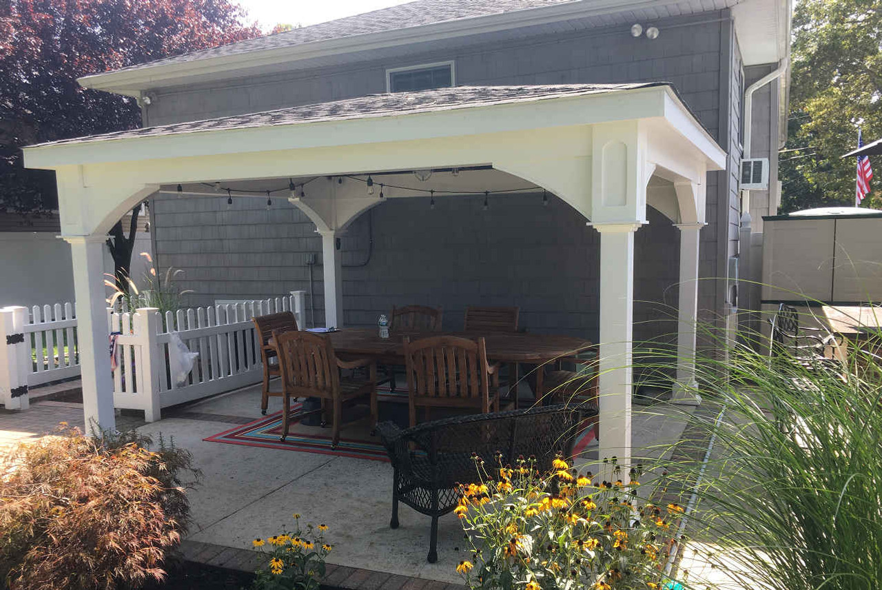 "12x14 Roof Span Vinyl Patio Cover Traditional (Hip) Roof / 3:12 Pitch Roof / Walnut stain on ceiling / Rustic Black asphalt shingles / Post height 7'-6"" (6"" lower than standard 8'-0"") / Massapequa, NY"