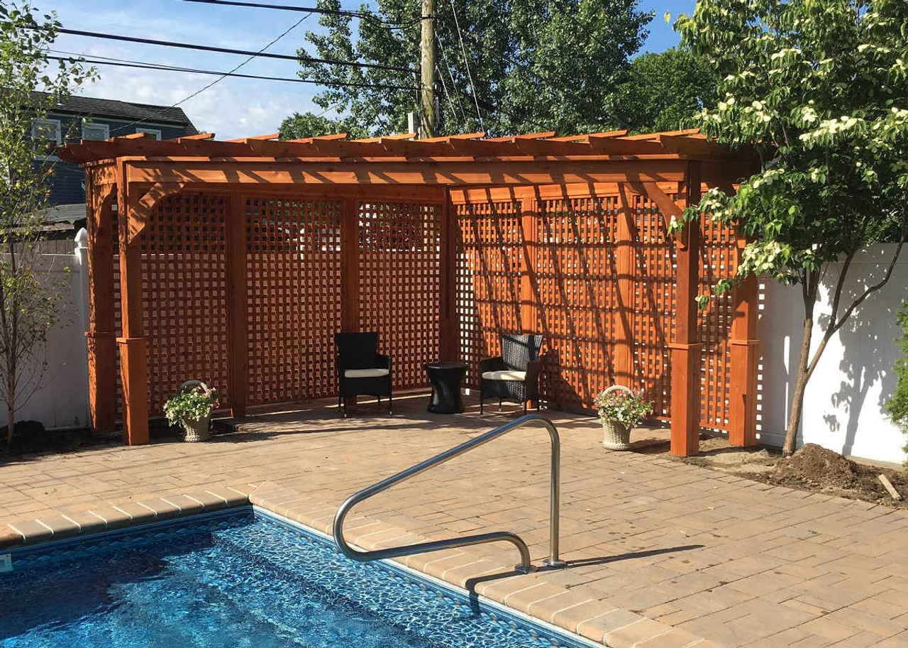 Triangle Pergola, Western Red Cedar, 14x14x20, Two 3ft extensions on either end, Cedar Stain and Sealant, Full Height Lattice Walls. Westbury, NY.