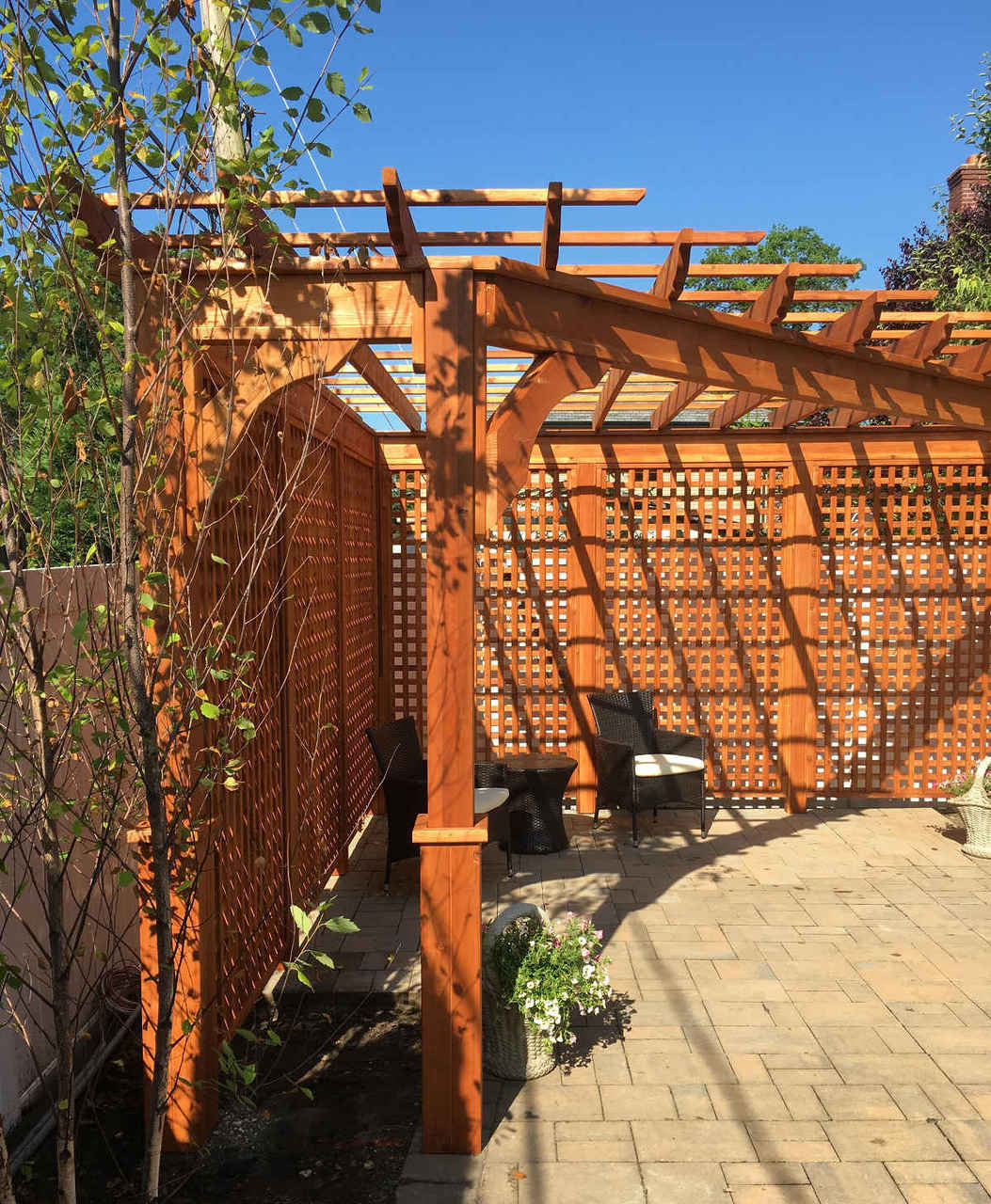 Triangle Pergola, Western Red Cedar, 14x14x17, Two 3ft extensions on either end, Cedar Stain and Sealant, Full Height Lattice Walls. Westbury, NY.