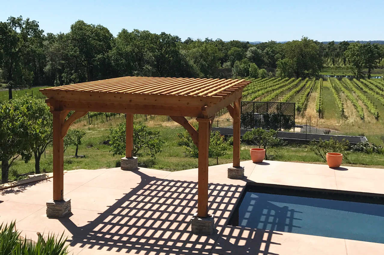 """Homestead Pergola Kit  12'-8"""" x 16'-8"""", tailed beams on outside of columns, corner braces rather than column top decorative molding, 3x10 rafters (rather than 3x8) at 24"""" on center, 2x4 top runners at 8"""" on center, all timber planed smooth, clear sealant, assembled in Santa Rosa, California."""