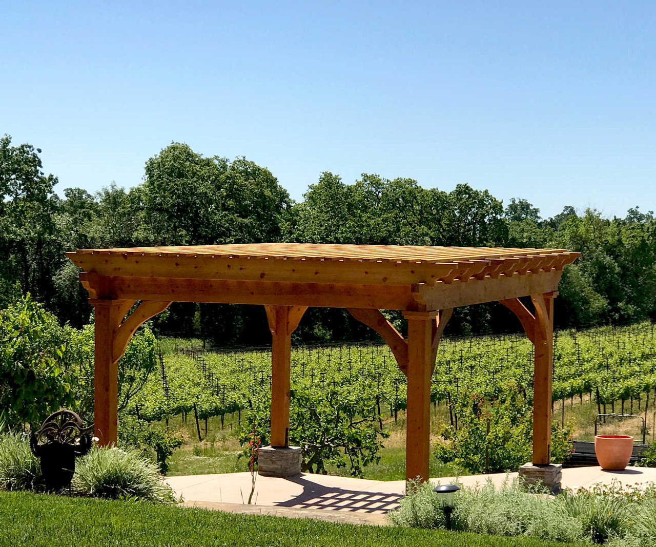 "Homestead Pergola Kit  12'-8"" x 16'-8"", tailed beams on outside of columns, corner braces rather than column top decorative molding, 3x10 rafters (rather than 3x8) at 24"" on center, 2x4 top runners at 8"" on center, all timber planed smooth, clear sealant, assembled in Santa Rosa, California."