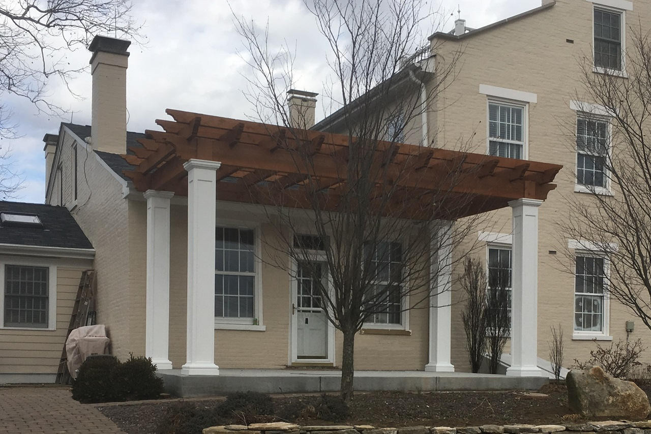 9x18 post centers / 11ft tall posts / Fiberglass post wraps / Kensington Rafter Tails / Cedar color stain & sealant / Aurora, IN