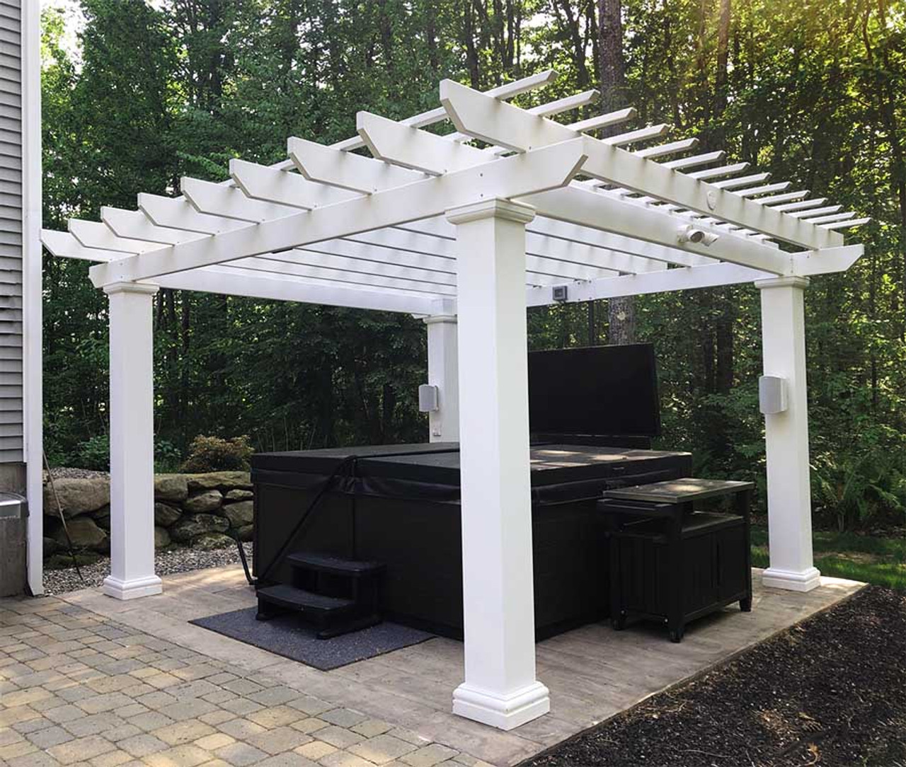"""Classic and Clean Avondale -The Avondale Fiberglass pergola kit ships in one week, features Napa Style rafter tails, and 10"""" square posts 8ft tall. Available in Standard White Color. This is a fiberglass-resin composite material warrantied for life. Available in 12x12, 14x14, and 16x16 sizes."""