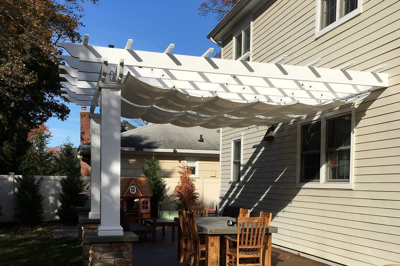 Shadow cast by retractable fabric canopy.