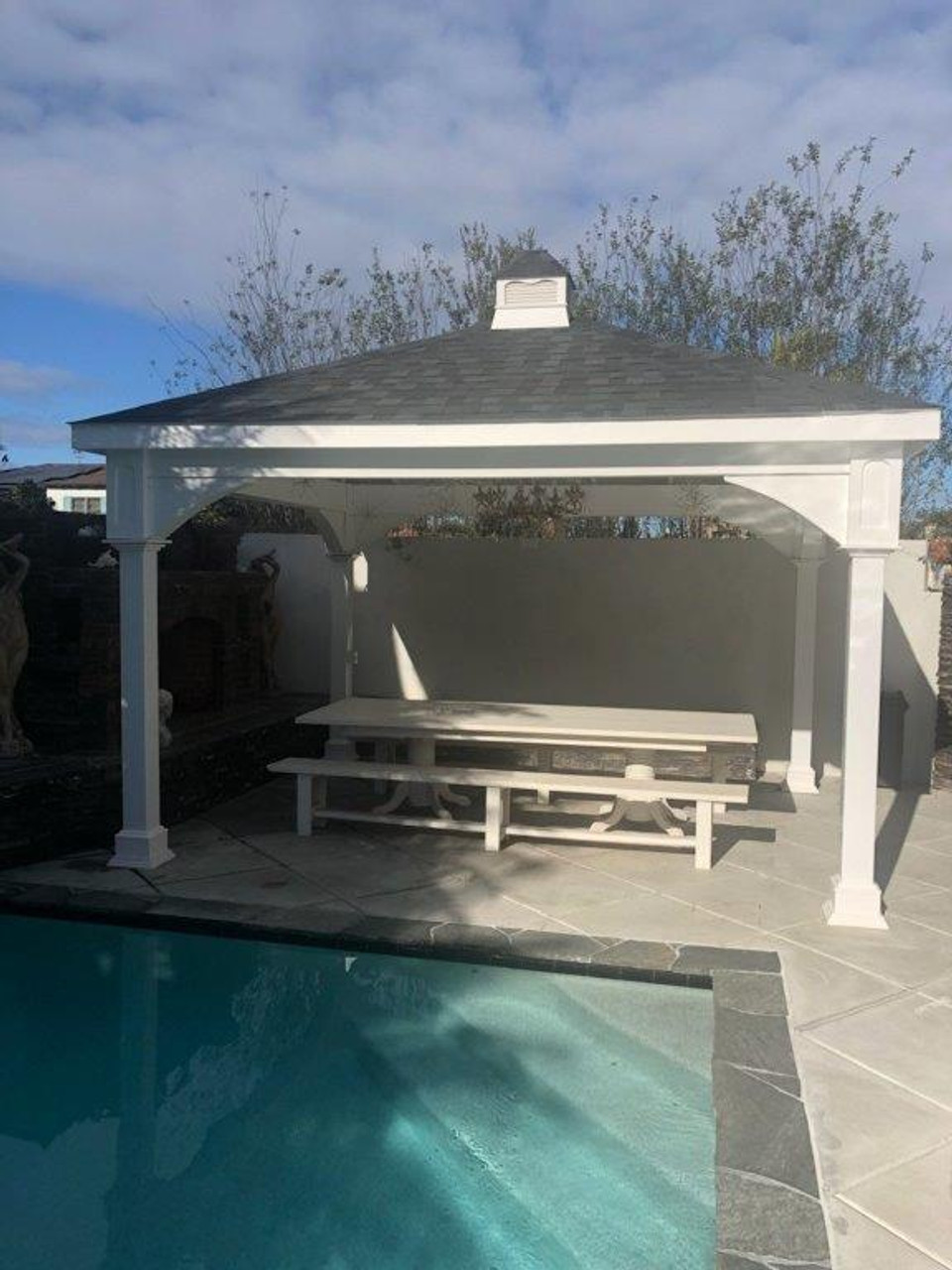 This customer made the most use of the limited space in her backyard with this pool pavilion, 12x14 Vinyl Traditional (Hip) Roof / Coronado California