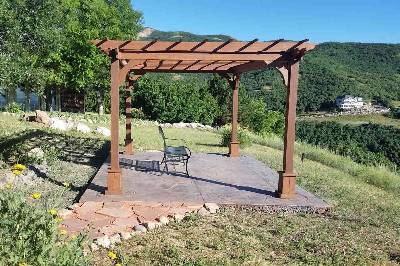 10x14 red cedar pergola (stained) creates a hilltop setting in Bountiful, UT.