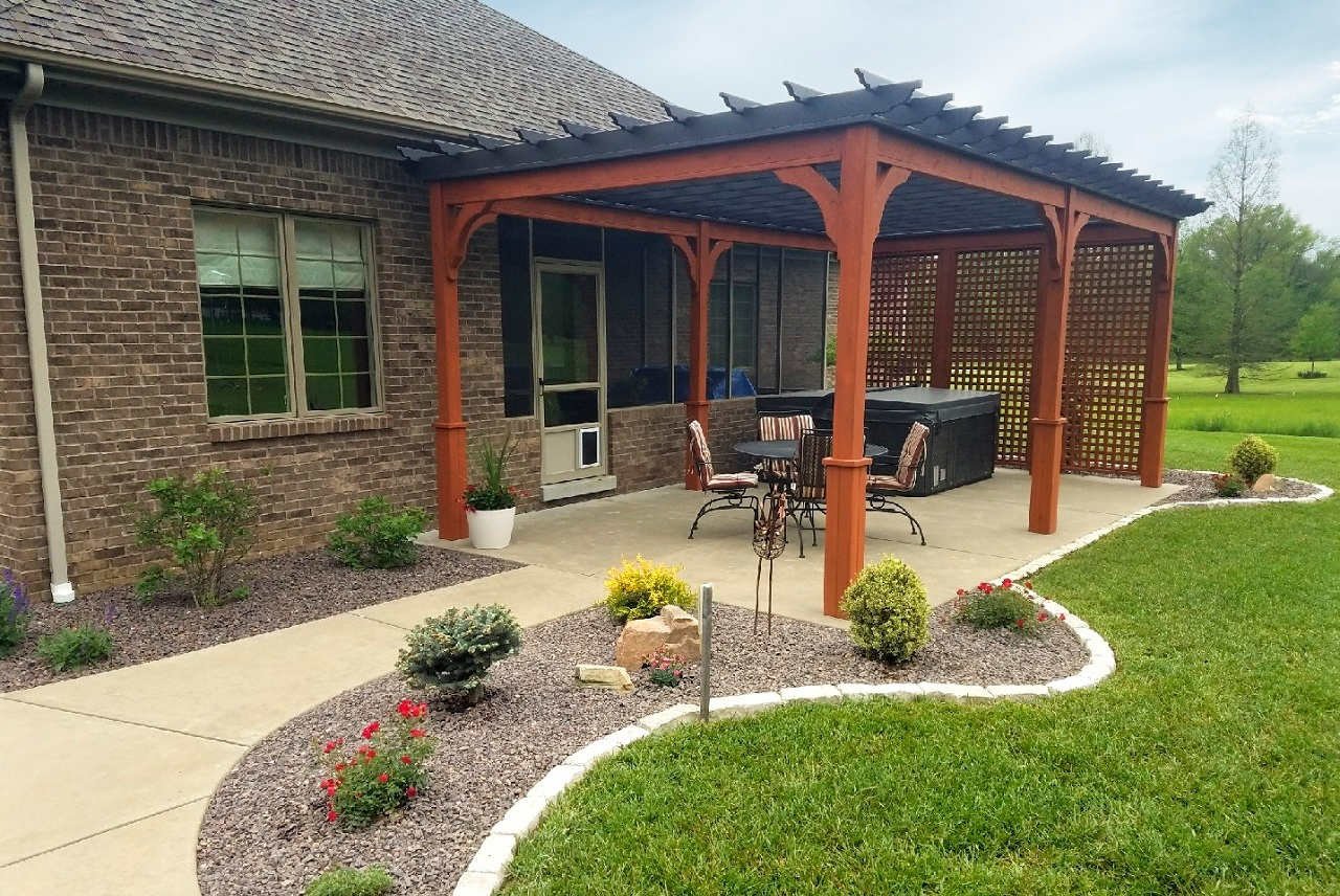 The customer did not want to mount the pergola to the wall, so simply nestled it close to the house.