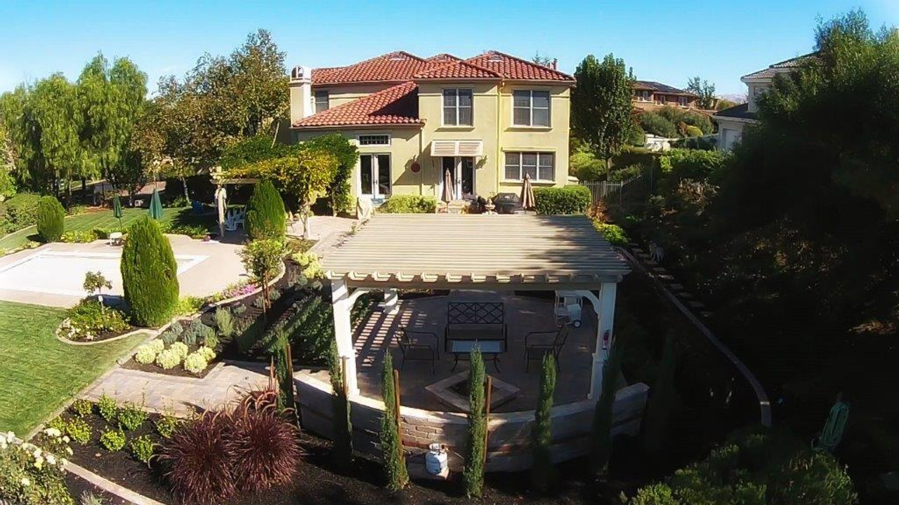 Bird's eye view of the home, pergola and garden on a sunny day in Pleasanton, CA.
