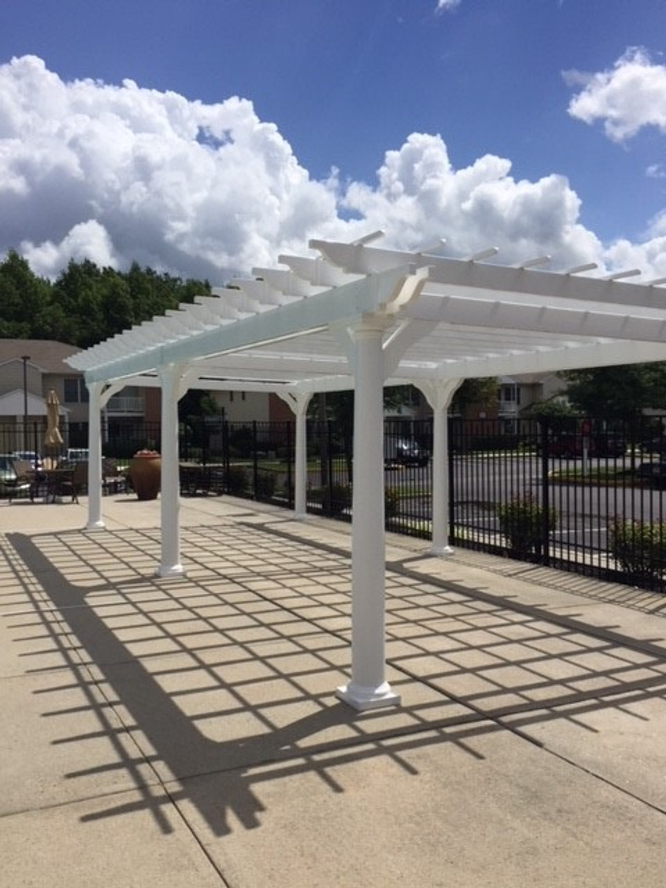12x28 Classic White Vinyl Pergola Kit - poolside at an apartment complex