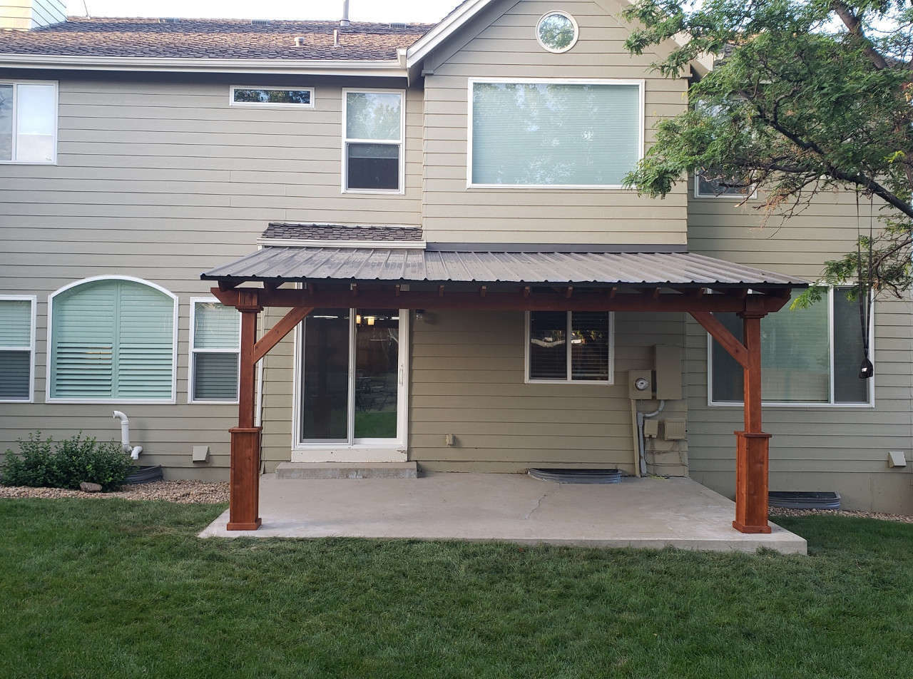 17x11 wall-mounted Lean-To roof. Parker, CO. Straight cut corner braces. Napa rafter tail design. Rafters flush-mounted to ledger board.