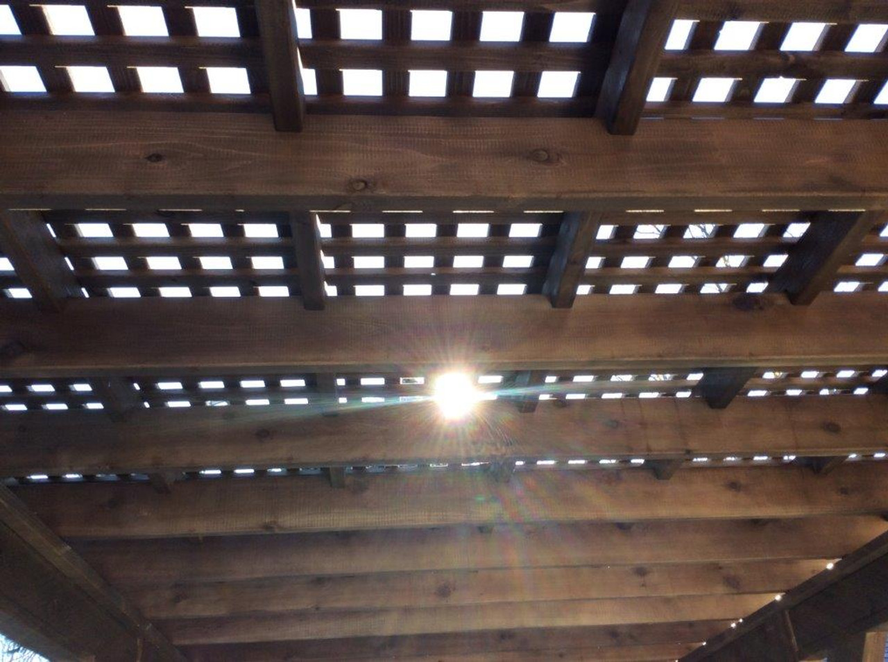 "Lattice roof stain walnut color. Consists of two levels of 1x2 cedar strips spaced 3.5"" o.c."