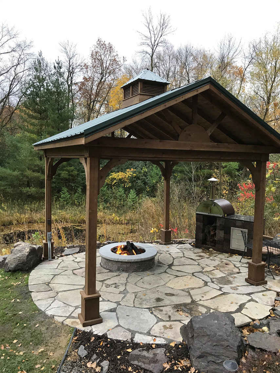 Fire pit and pavilion against the Minnesota woods.