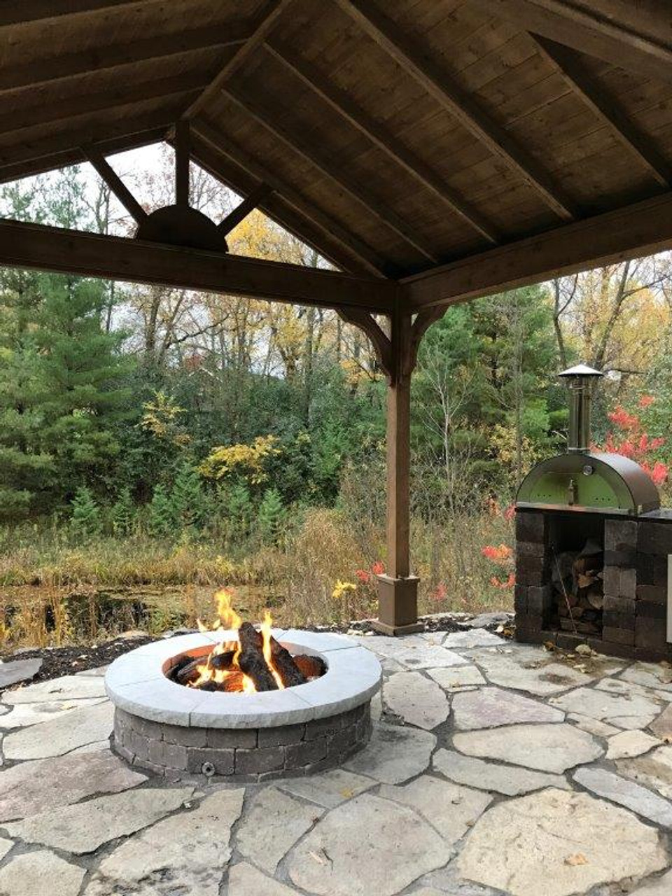 Customer photo shows operating fire pit. Open gable design and functional cupola provide adequate ventilation.