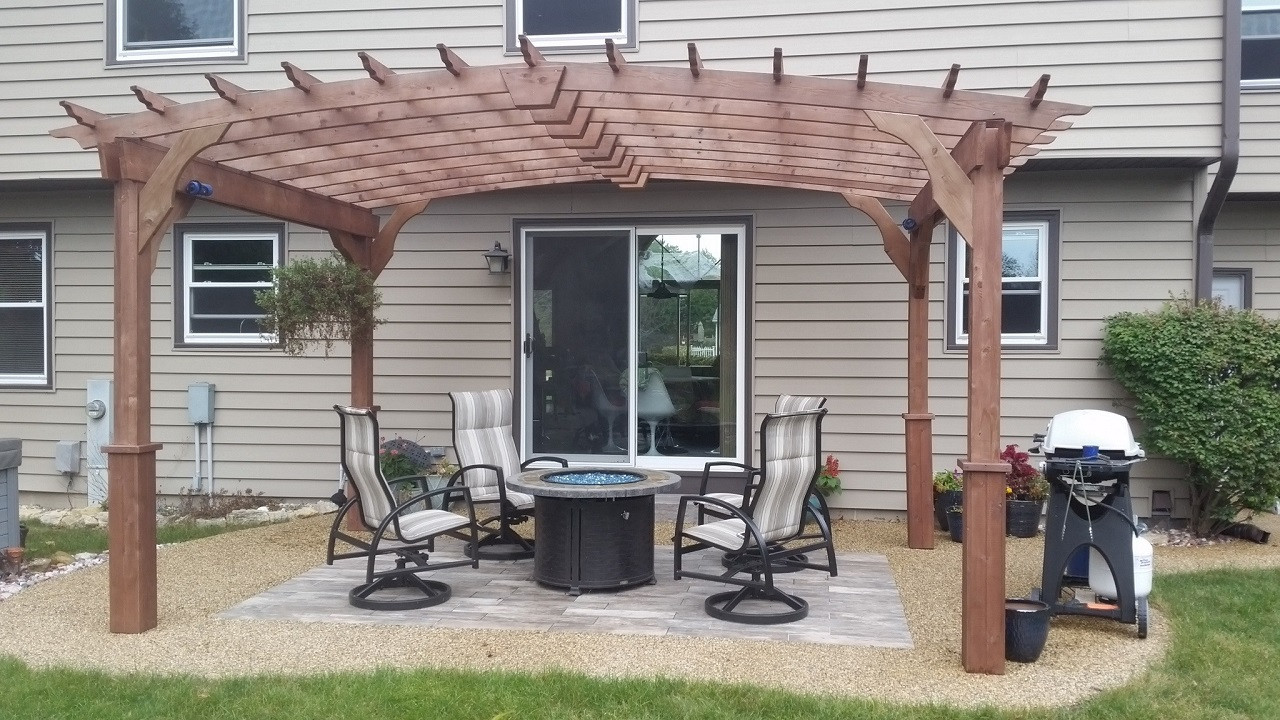 Pergola over epoxy pebble patio with gas firepit / Muskego, Wisconsin