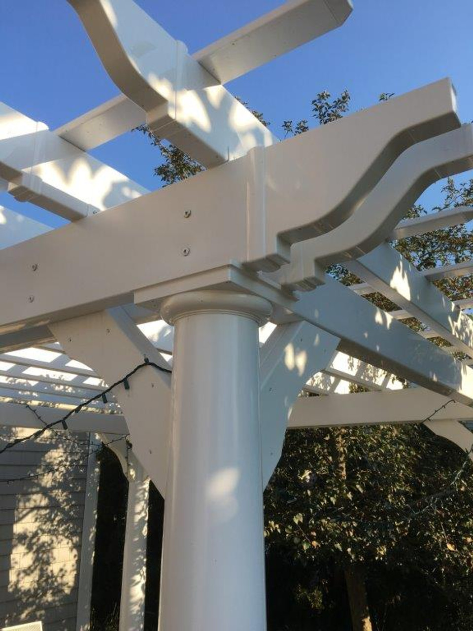 Close up of decorative rafter tails on the double 2x8 beams.