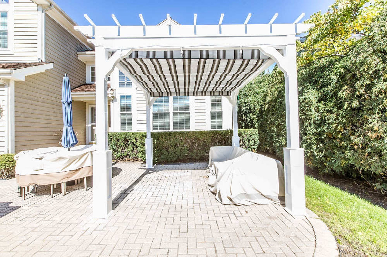10x12 Serenity Vinyl Pergola with retractable fabric canopy outdoor seating, Glenveiw, IL