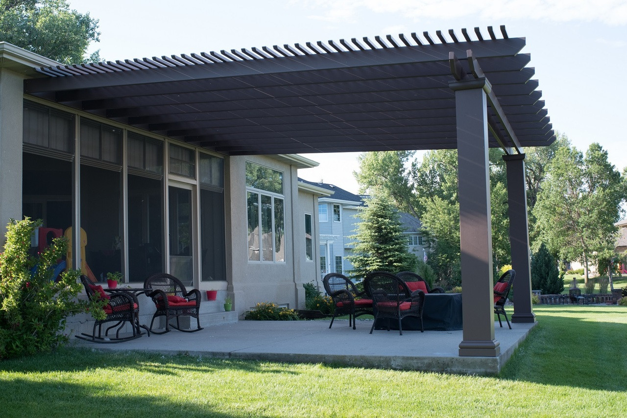 "Wall mounted structural fiberglass pergola kit / 18'-2"" x 19'-3"" / 12"" wide square posts, 9'-7"" tall / SW#2808 Rockwood Dark Brown / 2x2 top runners 5"" on center / 2x8 rafters flush-mounted to ledgerboard / Bismarck, ND"