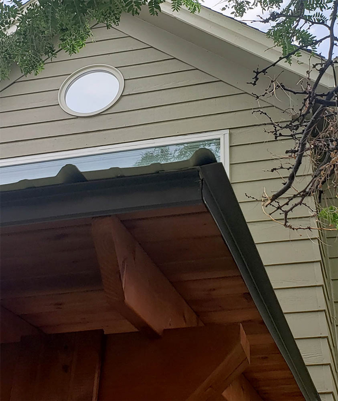 Rustic Cedar stain with Charcoal metal roof