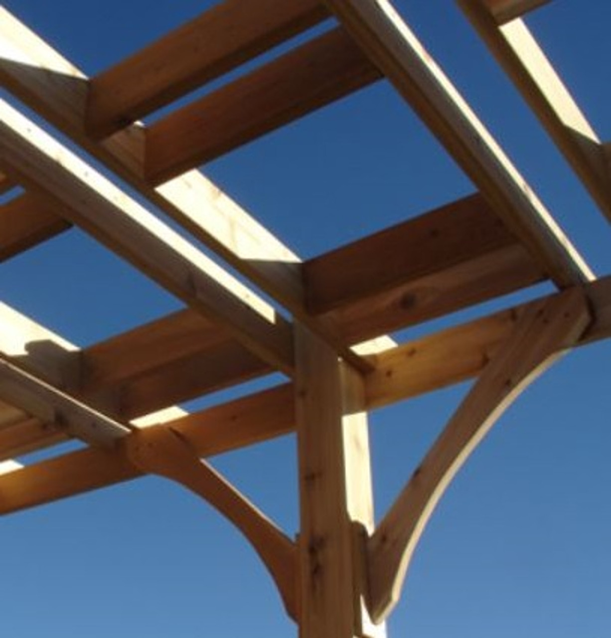 close up of Everlynn Cedar pergola kit timbers and rafters cropped