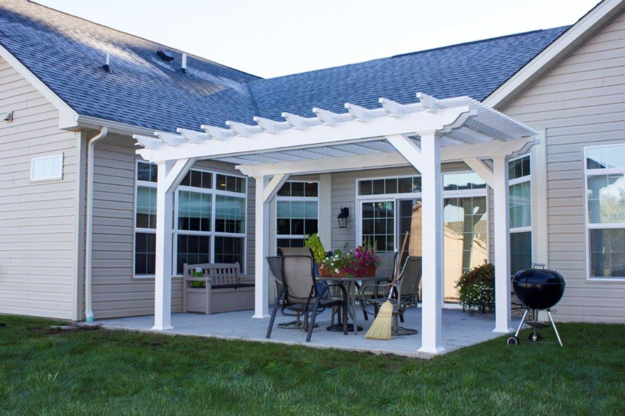 12x16 (roof span) Newport vinyl pergola kit on patio with dining chairs, with corner braces