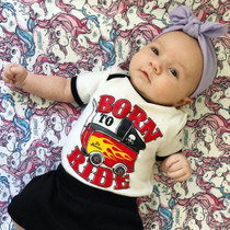 Six Bunnies Born to Ride Baby Onesie - model