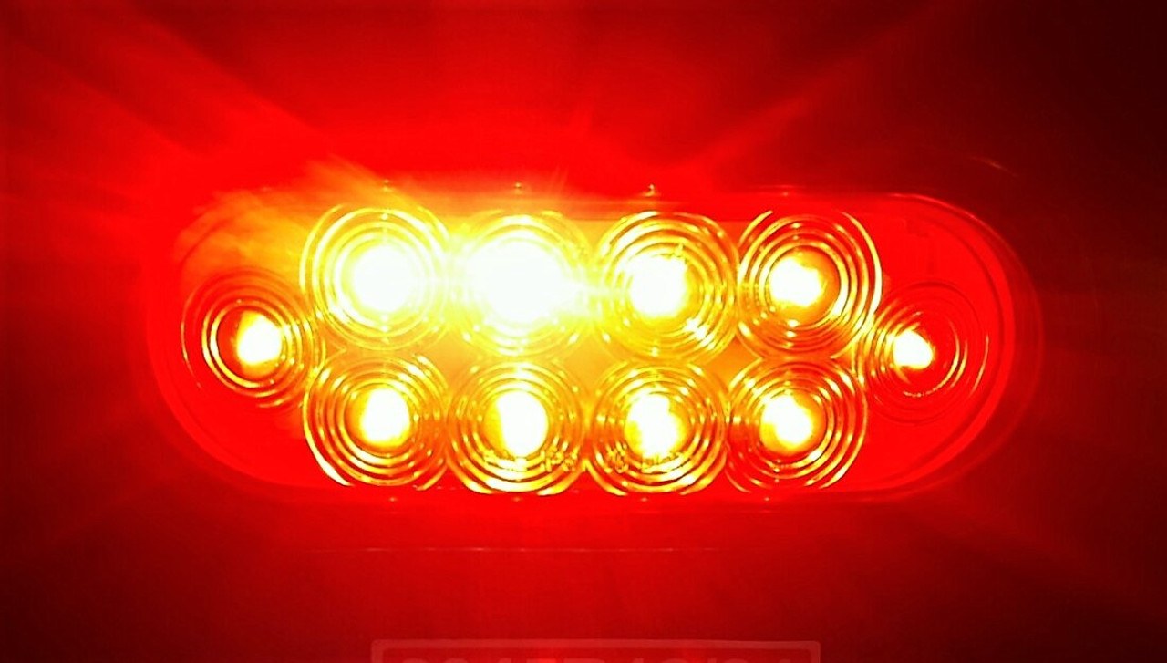 """6"""" Oval Red Stop, Turn, and Tail Strobe Light Grommet Kit - Lit Up"""