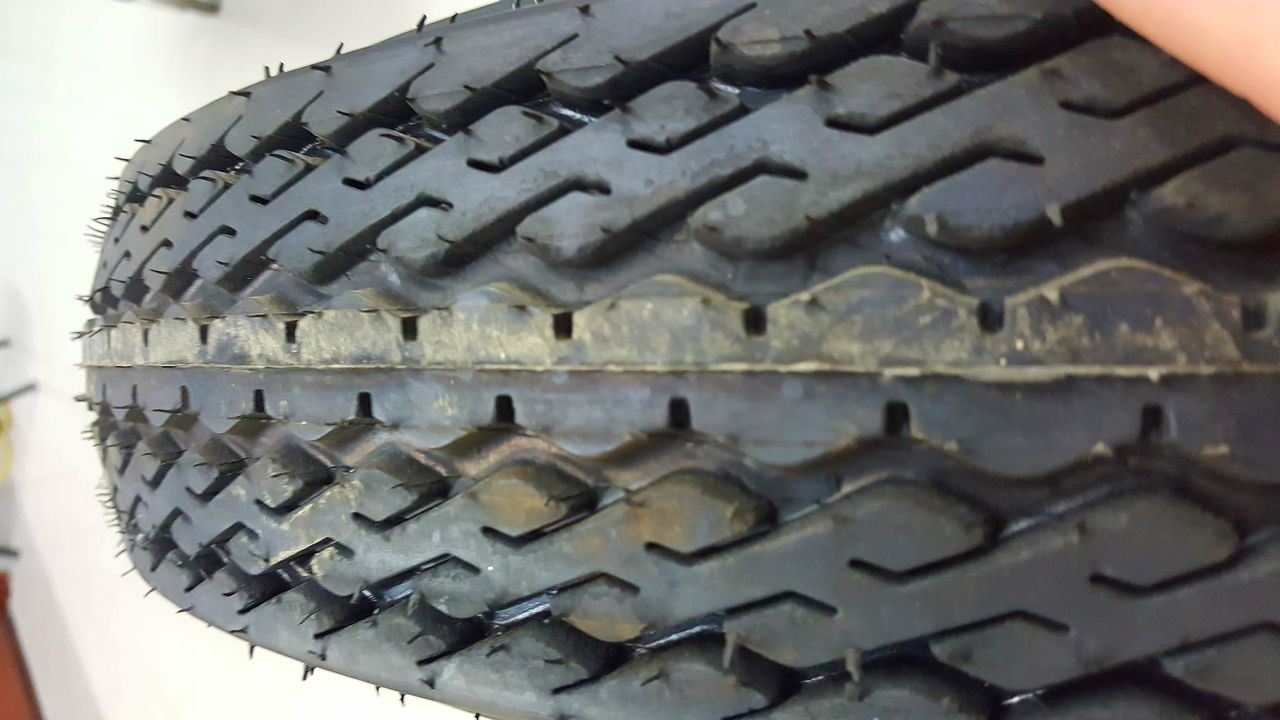 4.80-12 6-Ply Taskmaster Bias Tire on White Spoke 5x4.5""