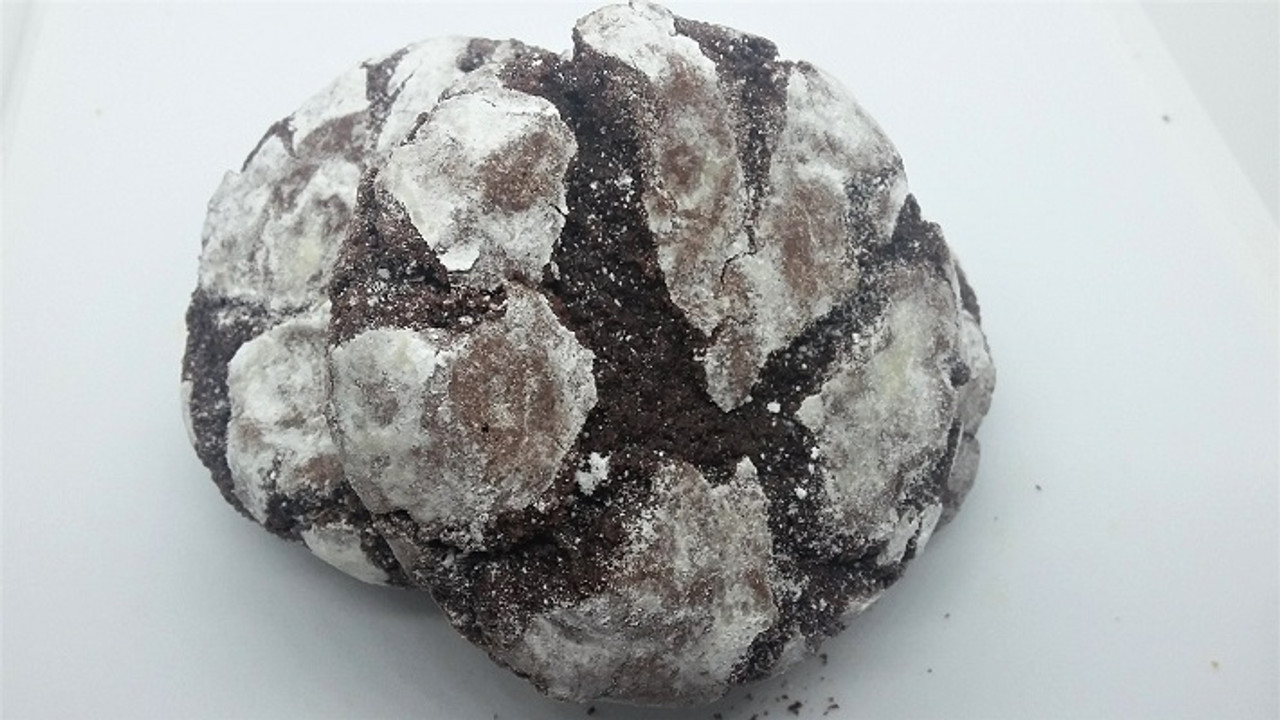 A fudgy chocolate crackle cookie dusted with powdered sugar.
