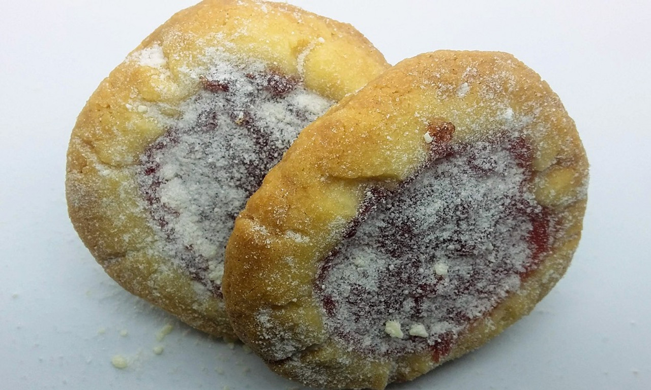 Lemon snow cookies filled with raspberry and topped with white chocolate powdered sugar.