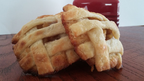 Soft sugar cookie rolled in raw sugar, filled with apple pie filling and latticed with buttery pie crust and apple spice sugar.