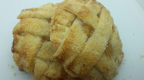 Soft sugar cookie filled with peach pie filling spices with cinnamon and vanilla baked with lattice  butter pie crust sprinkled with cinnamon sugar.