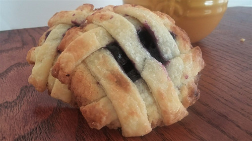 Soft sugar cookie baked with organic blueberries and vanilla pie filling topped with a buttery pie crust and raw sugar.