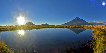 Taranaki reflected in Pouakai tarn at sunrise