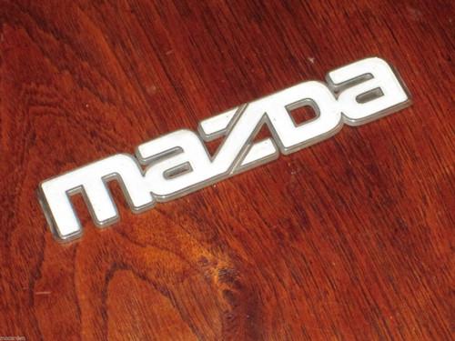 Mazda orig. white faced CAR BADGE chrome/plastic 25mm high, 143mm long FREE POST