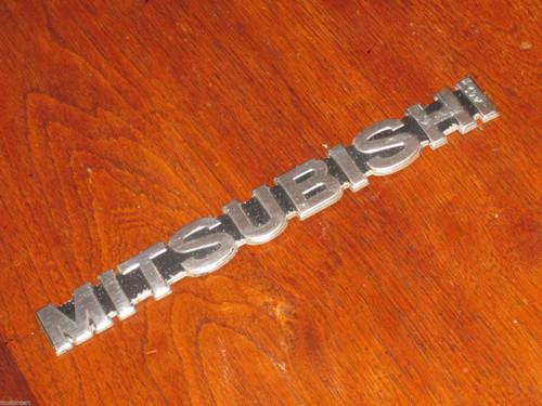 """MITSUBISHI"" chrome on black CAR BADGE EMBLEM 5 11/16"" or 151mm long, FREE POST"