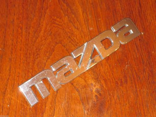 Mazda NICE original CHROME CAR BADGE plastic 157mm long, 27mm high FREE POST